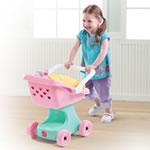 Little girl pushing baby doll in stroller