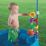 Child pouring water in funnel on Play & Shade Pool