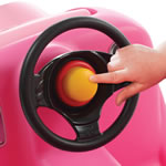honking horn and steering wheel of toddler's ride-on car