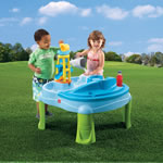 kids playing with outdoor activity table