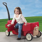 Toddler exiting red wagon