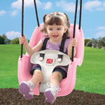 Pink Infant to Toddler Swing with child swinging