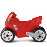 kids riding on pretend motorcycle toys