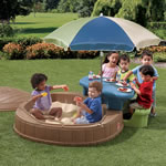 Kids playing with sand and play table set