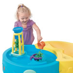 Girl playing with water table