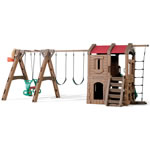 Children playing on backyard swing set with glider