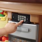 Kids playing with interactive play kitchen