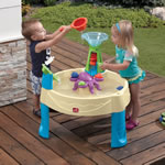 kids playing with colorful plastic sensory play table