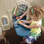 Kids playhouse kitchen with outdoor grill