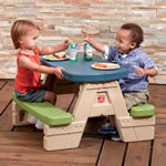 Snack time at kid's plastic picnic table
