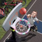 Girl scores a basket with adjustable basketball set