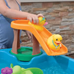 duck sliding on plastic water table