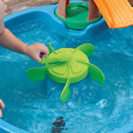 jumping frog into kid's water table