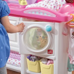 Hang up clothes on toy nursery
