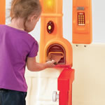 Inserting mail into playhouse mailbox