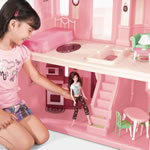 pretend play in kid's dollhouse