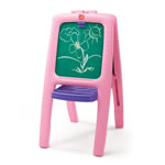 Girl drawing on chalkboard of easel