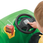 Steering wheel on green push buggy