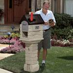 Woman getting mail from the Step2 mailbox