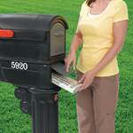 Putting plastic mailbox on post
