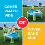 Toddler playing with sand part of activity table