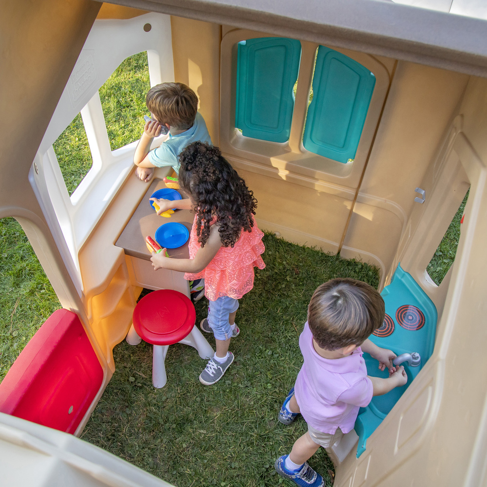 Fold down table in playhouse