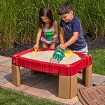 Sandbox lid has molded-in roadways for added fun