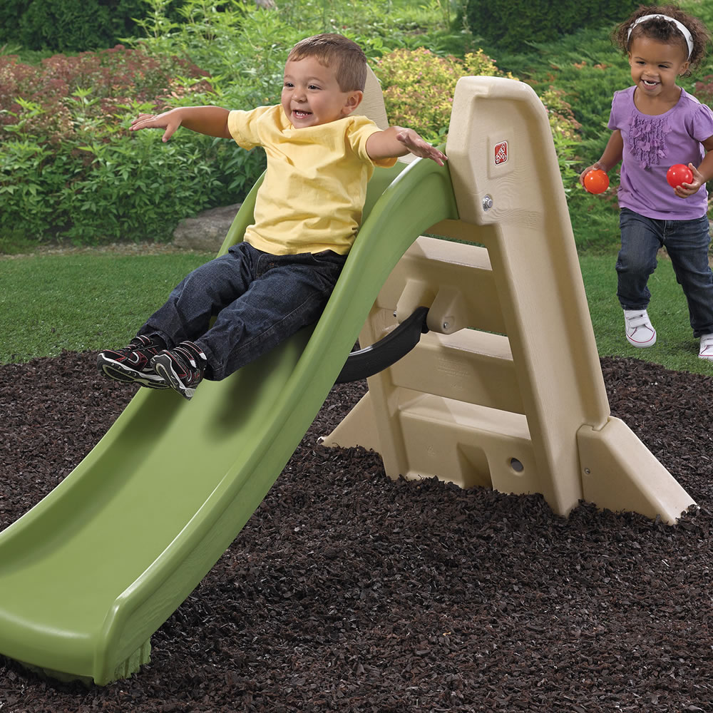 Preschooler sliding down the slide