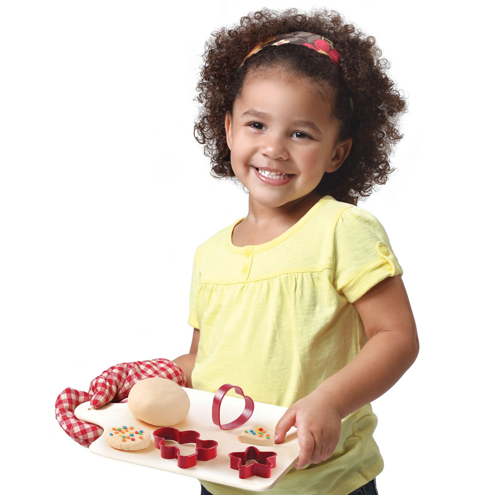 Little girl playing with baking set