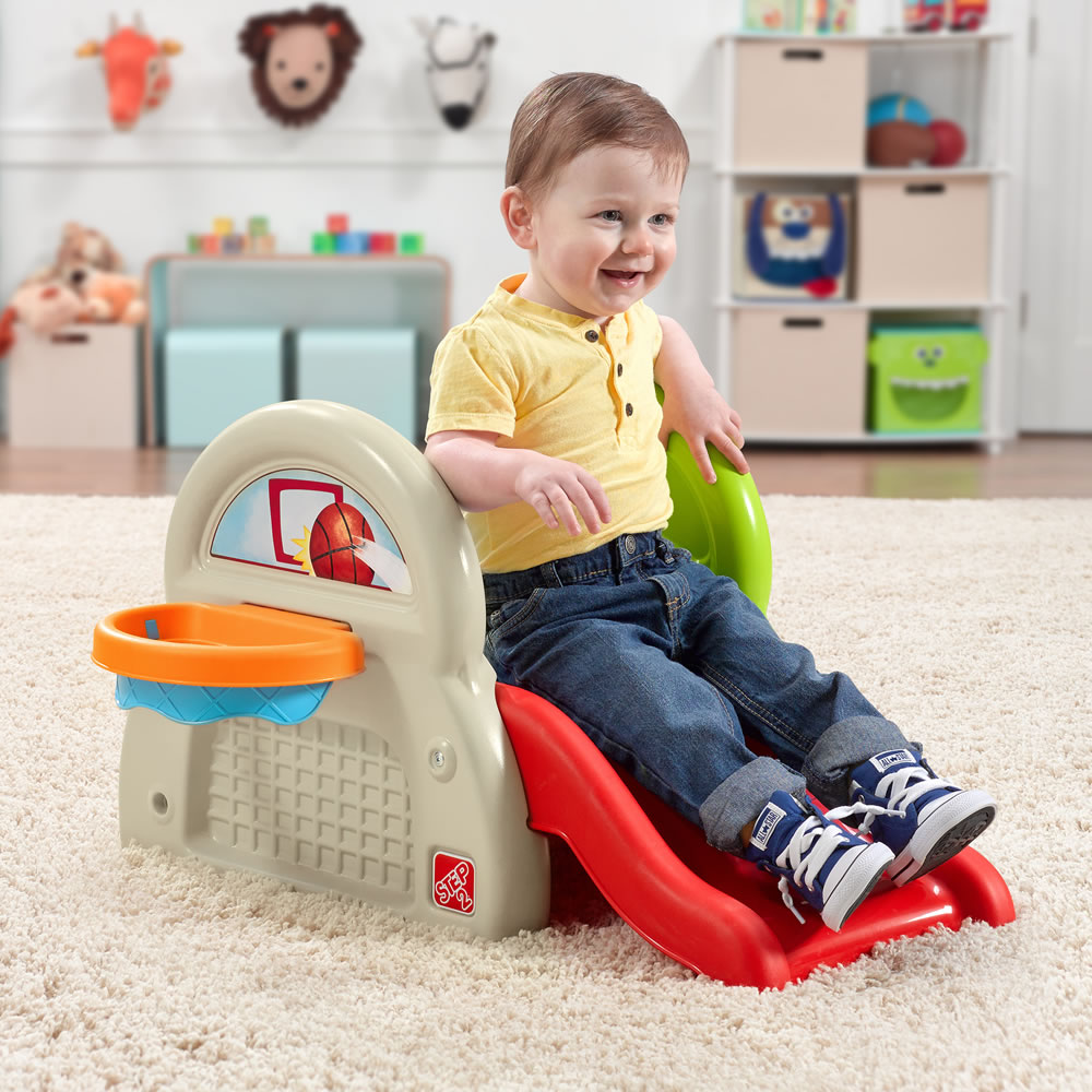 Toddler playing with activity center