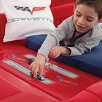 Boy racing cars in car bed