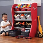 Boy putting toys into room organizer