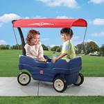 Kids riding in blue wagon