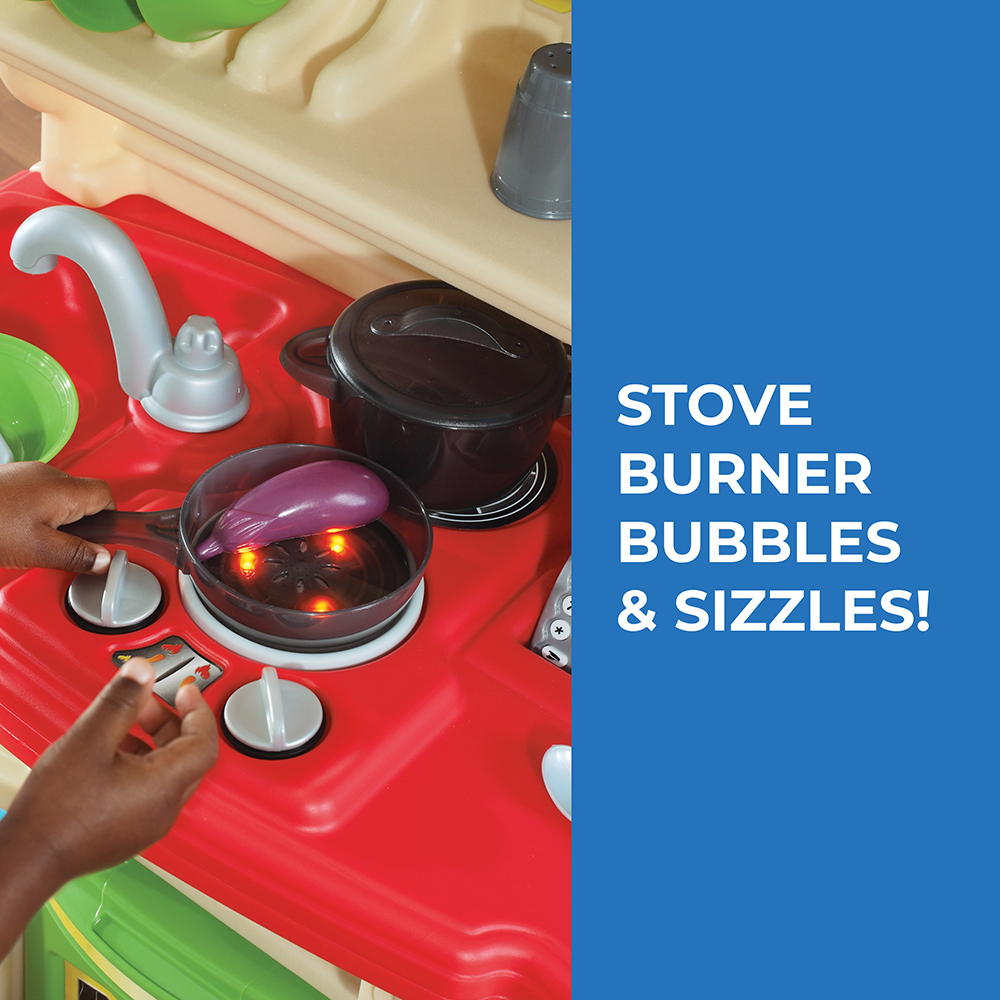 Stove top of colorful plastic play kitchen for kids