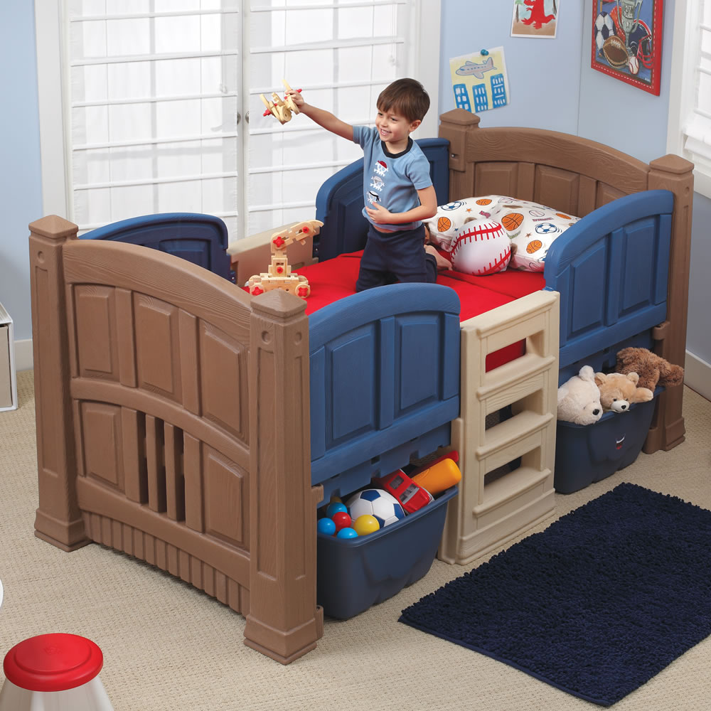 Little boy in blue twin bed