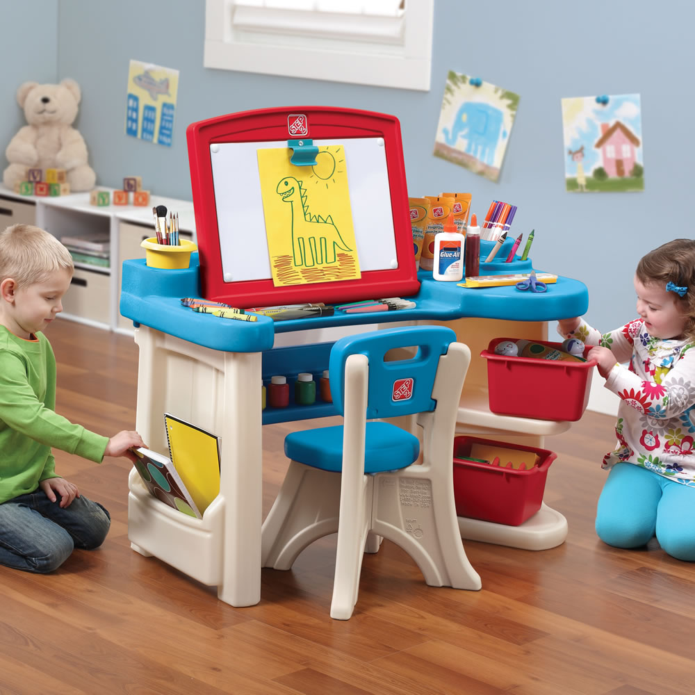 Kids playing with art desk and easel