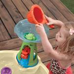 pour water into vortex of kid's activity table