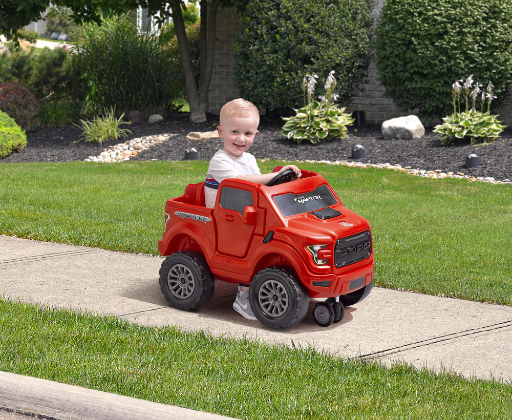 Toddler riding in toy truck