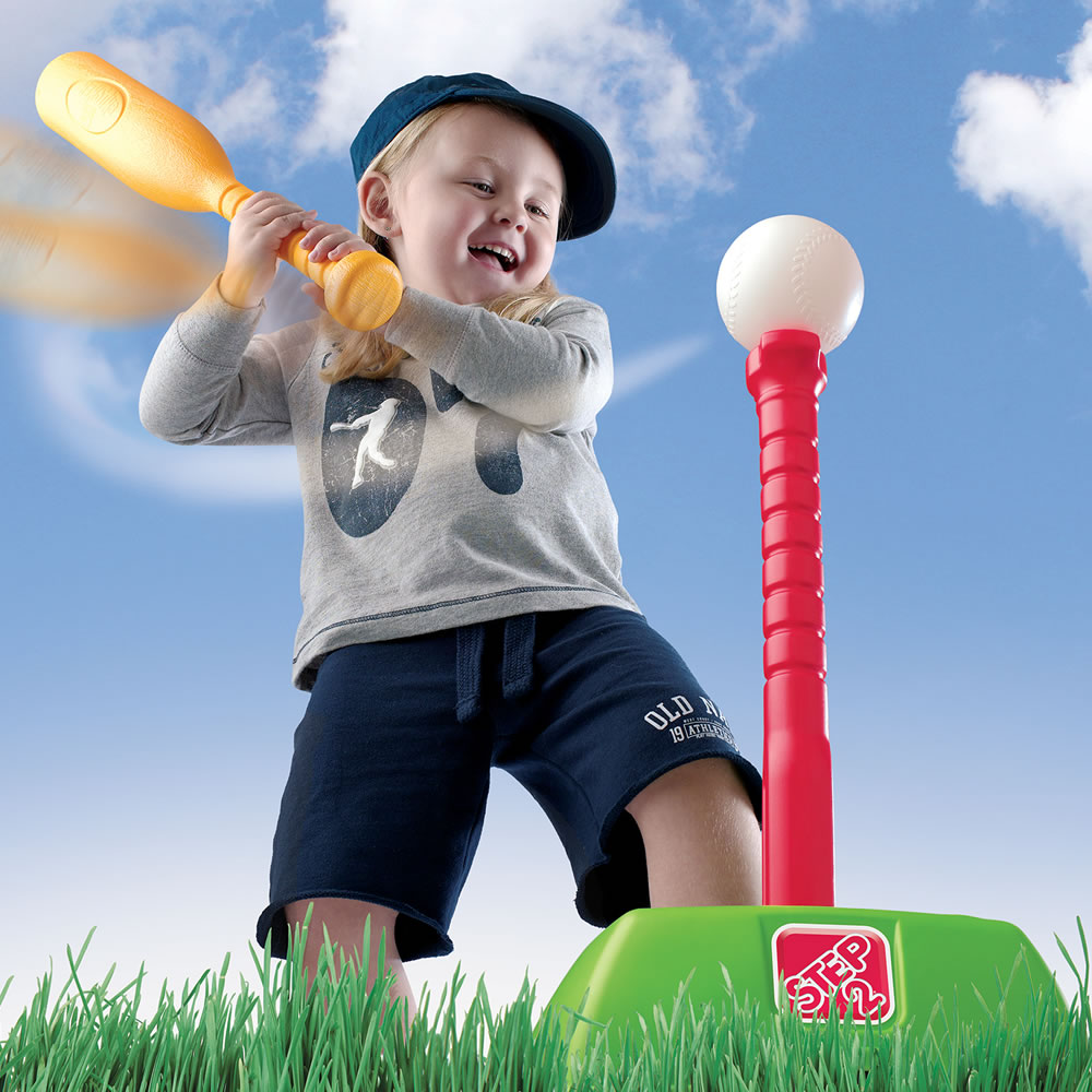 Child swinging and hitting the t-ball