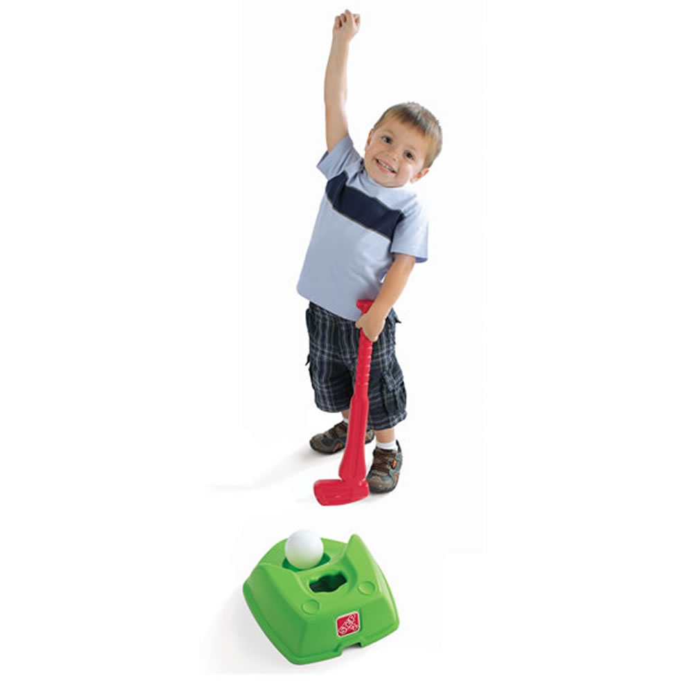 Kid swinging golf club