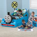 little boys playing with toddler train bed