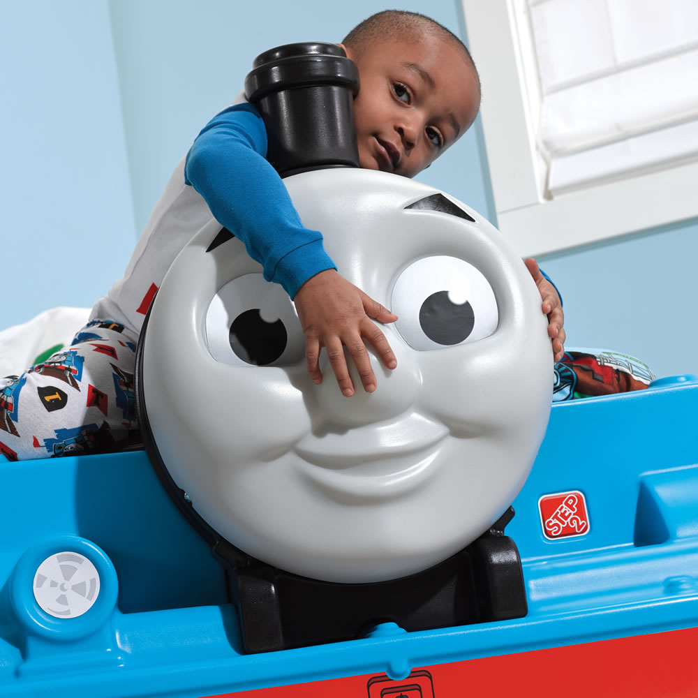 toddler playing with realistc 3D face of Thomas bed
