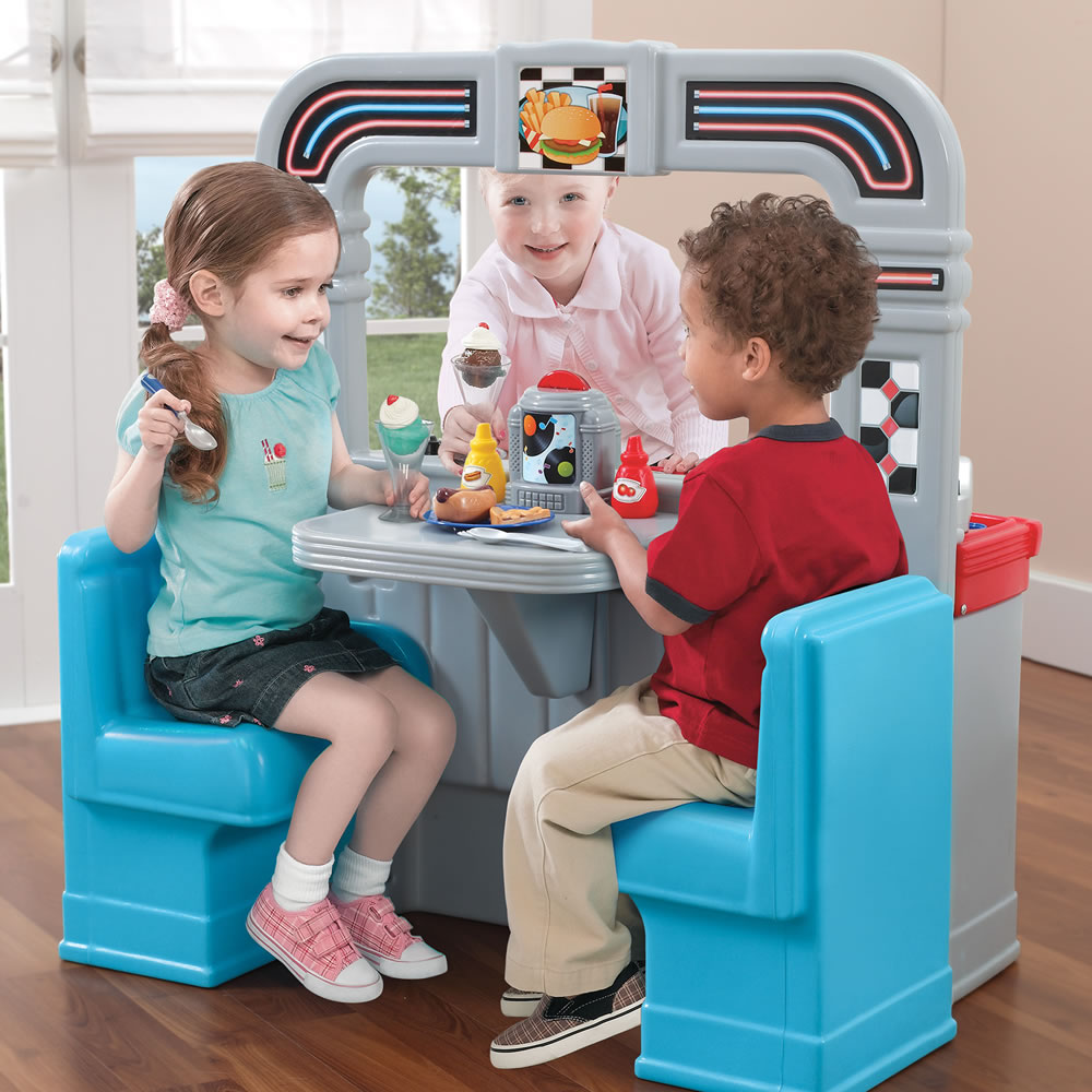 kids playing with 1950's inspired play kitchen