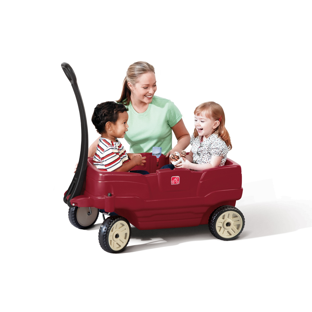 Mom folding under handle of the kid's red wagon