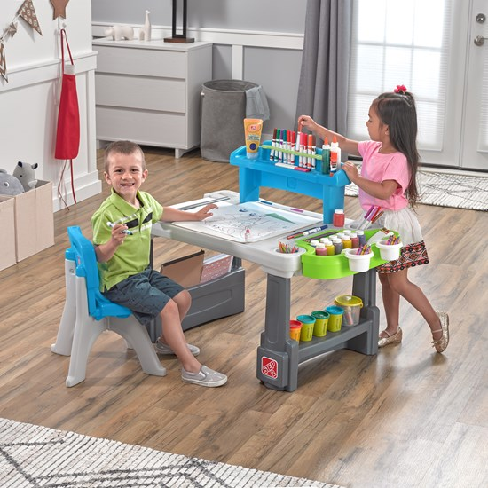Boy and girl playing on Step2 Deluxe Creative Projects Art Desk