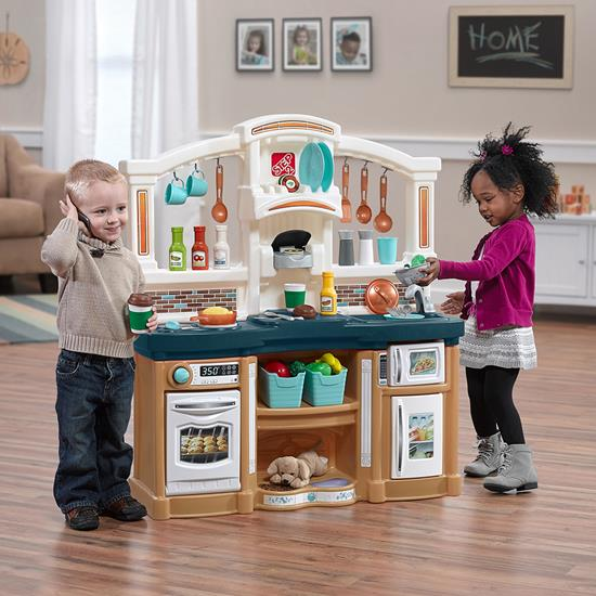 Two kids playing with Step2 Fun With Friends Kitchen in Blue