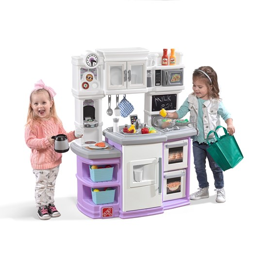 little girls playing with step2 great gourmet kitchen lavender