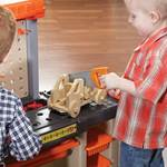 Step2 Handyman Workbench - Orange kid using toy saw