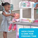 Two girls playing with Step2 Love & Care Deluxe Nursery in Lavender