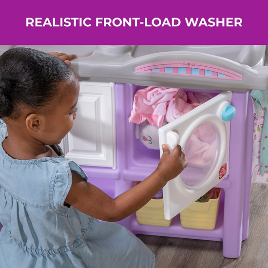 Girl opening washer Step2 Love & Care Deluxe Nursery in Lavender